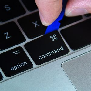 Pry the Command keycap from the top right