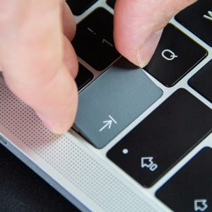 Slide the keycap upwards towards the screen